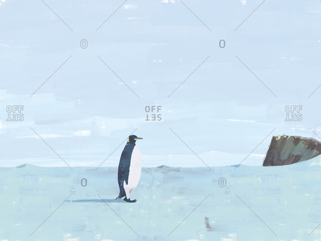 Emperor penguin in a harsh Antarctic landscape