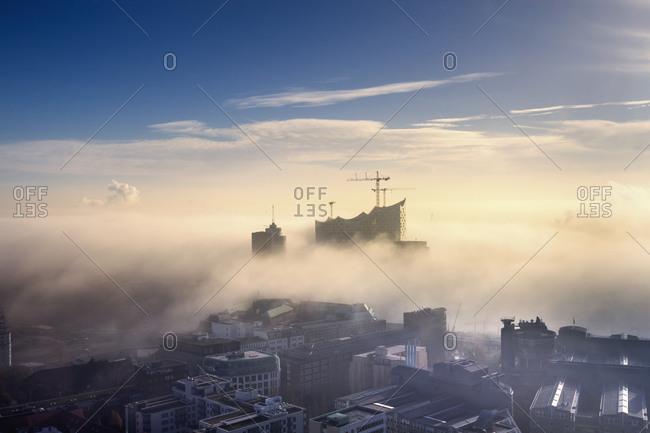 Hamburg, Germany - December 5, 2014: Aerial view of the Elbphilharmonie and city in dense fog, Hamburg
