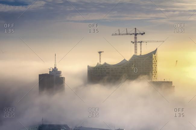 Hamburg, Germany - December 5, 2014: Aerial view of the Elbphilharmonie in dense fog, Hamburg