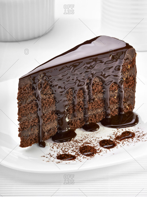 Piece of cream chocolate cake on white plate
