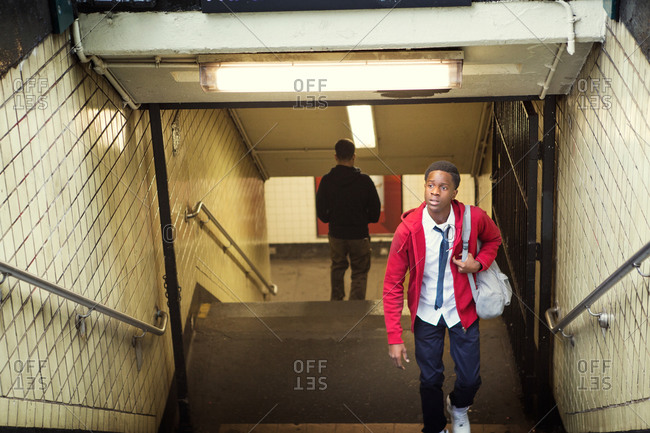 Teenage boy ascending from the subway in New York City, USA