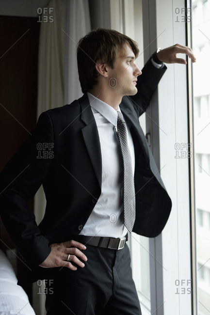 Man in suit at hotel room window