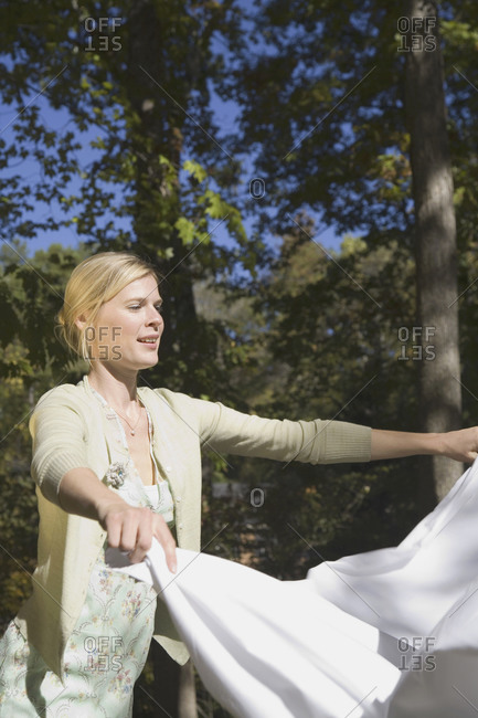 Woman with sheet outside