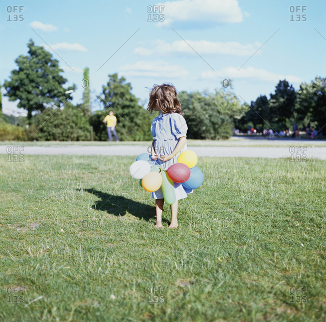 A girl wearing balloons in park