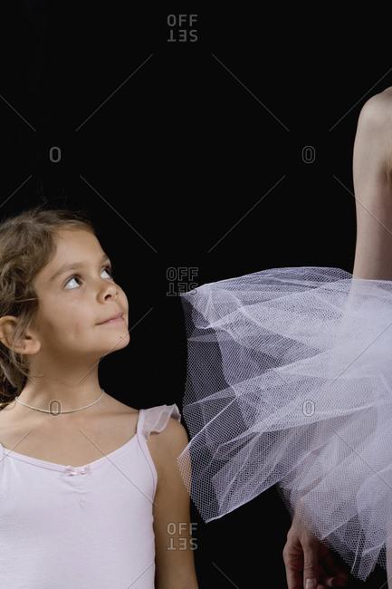 Young ballerina admiring older