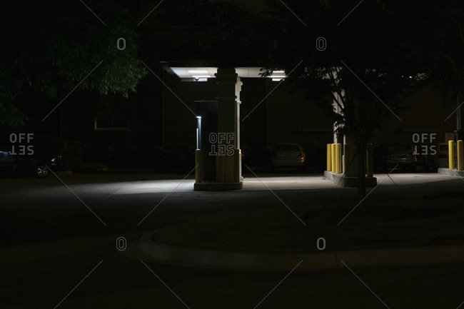 Gas station pumps at night