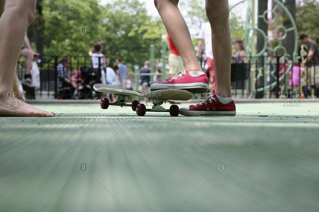 Skater's feet and skateboard