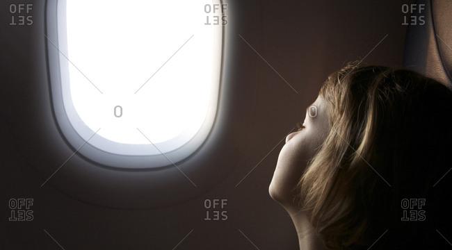 Girl asleep on plane