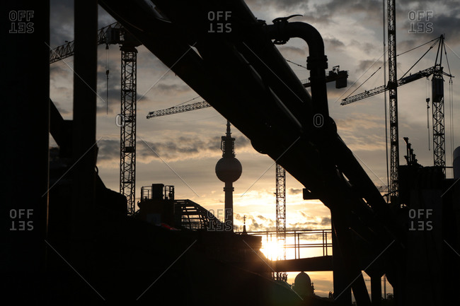 Industrial site silhouetted by sunlight