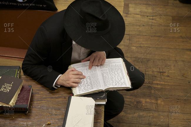 A Jewish man reading religious texts