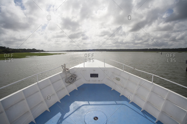Front of a boat in waterway