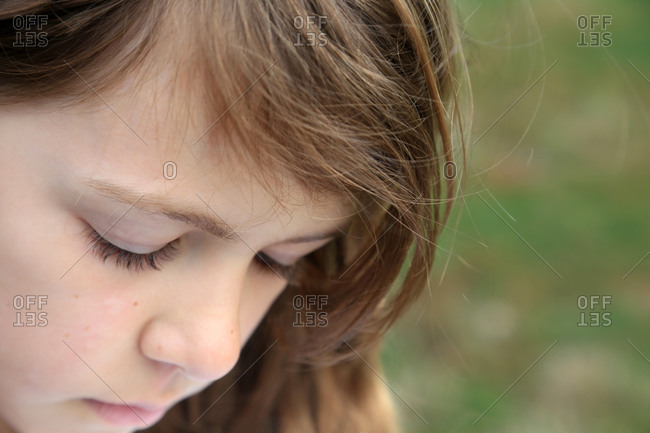 Portrait of young girl looking pensive
