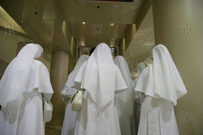 Nuns walking in modern building