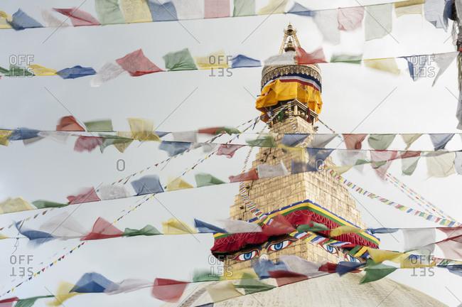 Stupa sanctuary with prayer flags, Bodnath, Nepal