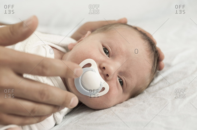 Baby sleeping father hand dummy mouth