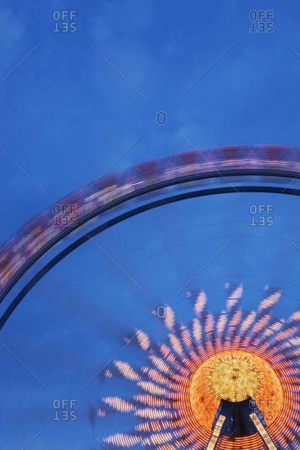 Illuminated Ferris wheel at night Oktoberfest beer festival Munich Germany