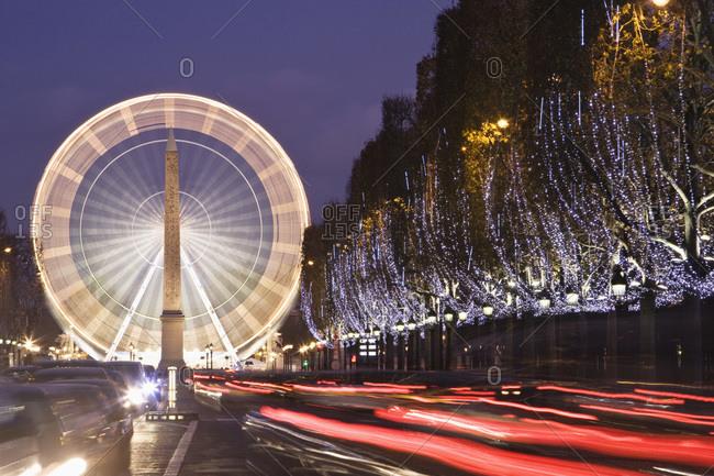 Big wheel and Obelisk on Place de la Concorde at night Paris France