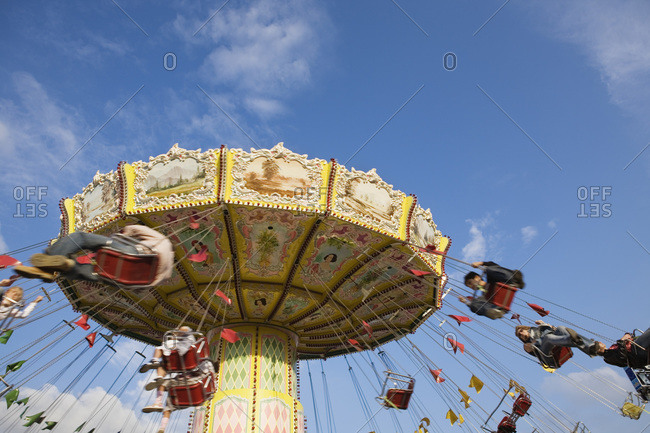 People riding on carousel at Oktoberfest beer festival in Munich Germany