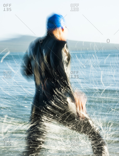 Competitor running towards the water during a race