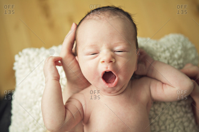 Top view of a yawning baby