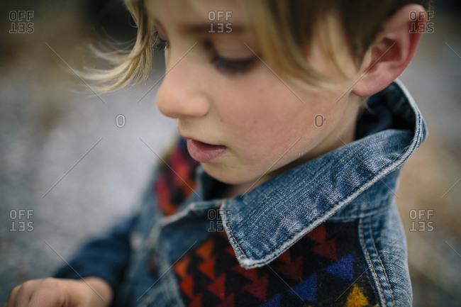 A little boy in a jean jacket