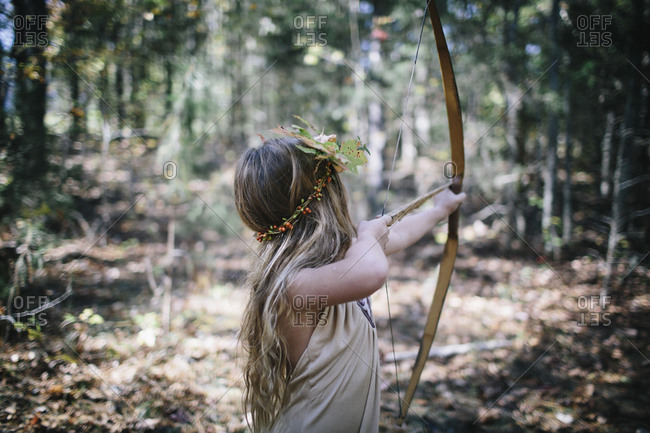 A girl dresses up as a forest warrior