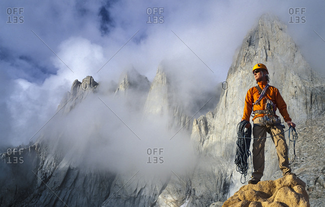 Climber on the summit of a cliff