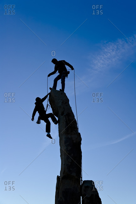People climbing up a rock formation