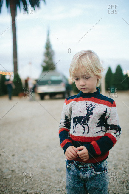 Boy standing in Christmas sweater