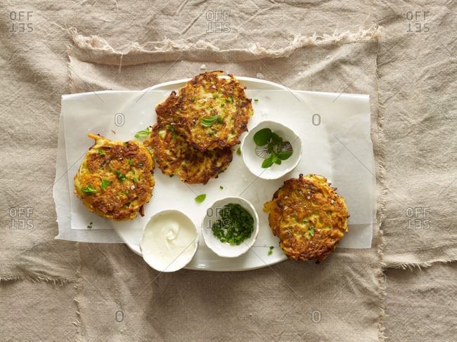 Root vegetable pancakes with fresh herbs and creme fraiche