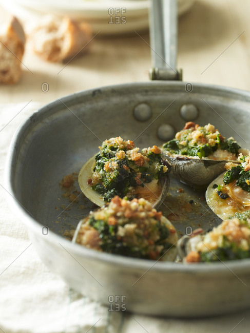 Roasted clams with spinach and herb butter