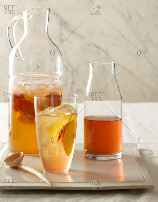 Peach juice in a bottle and glass