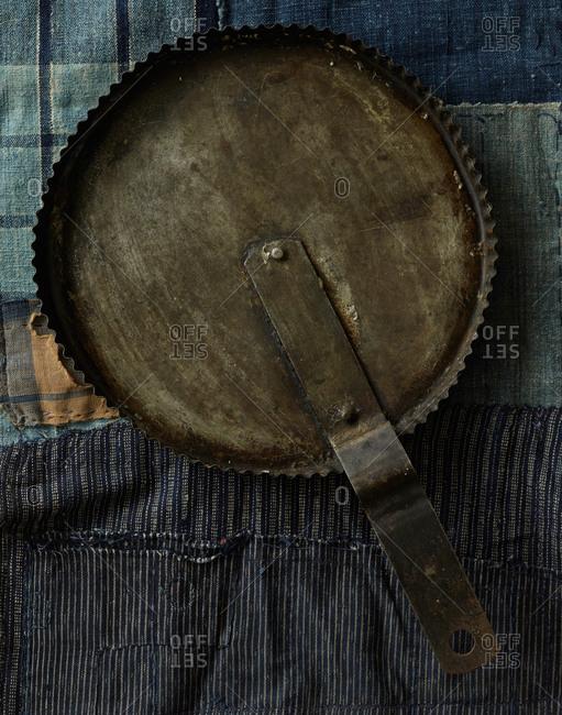 Old skillet on tablecloth