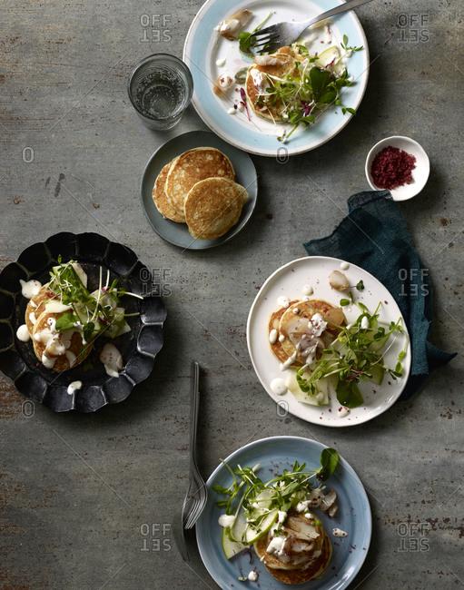 Savory pancakes served on plates