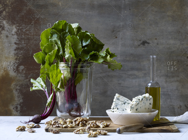 Beetroot, walnuts, olive oil and blue cheese on a table