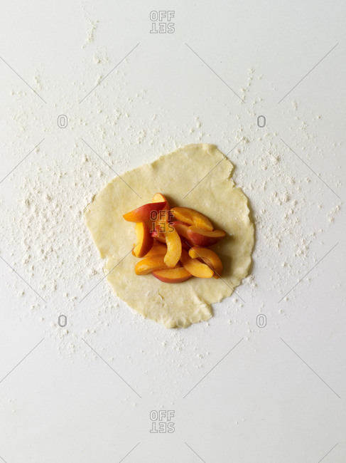 Dough being filled with apricots