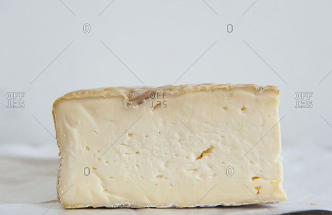 Side view of piece of cheese