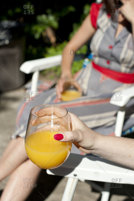 Women having mimosa cocktails outdoors