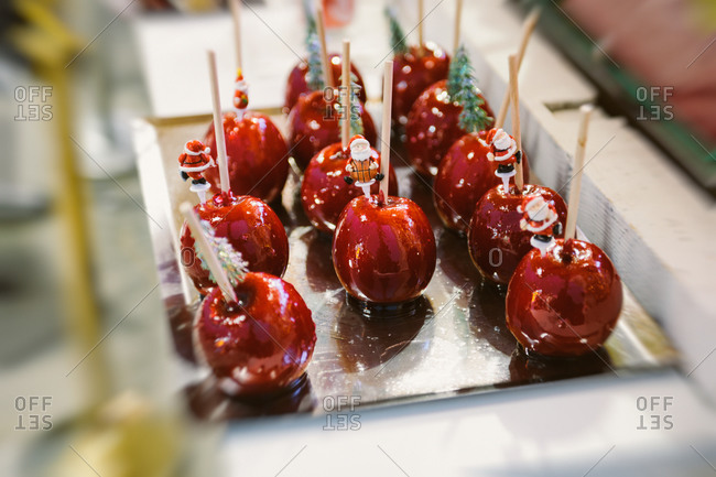 Shiny red candy apples at Christmas Market in France