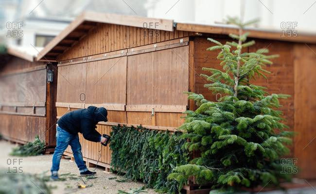 Man preparing stall for Christmas Market in Germany