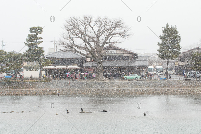 March 10, 2014: Shop along Kamo River in Kyoto, Japan