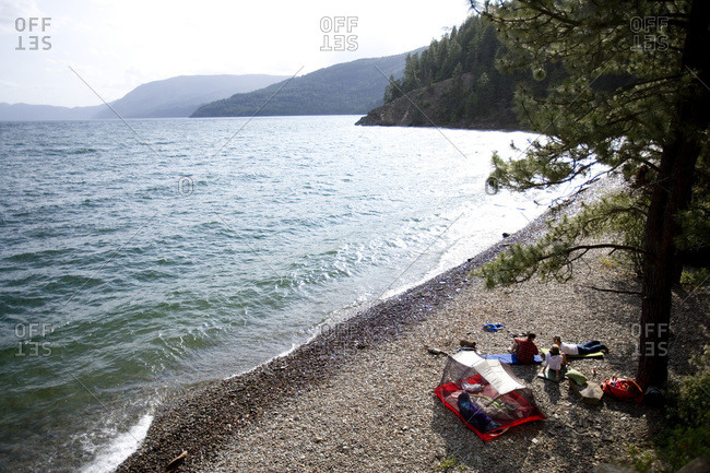 High angle view of friends camping along shore of Lake Pend Oreille, Idaho