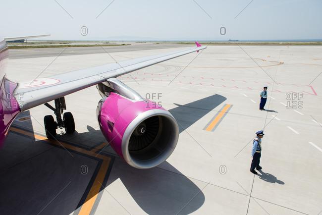 Japan - May 17, 2014:Plane and security guards at Kansai International Airport
