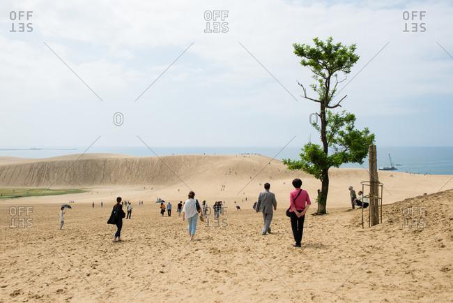 Tottori, Japan - June 7, 2014: Visitors at sand dunes