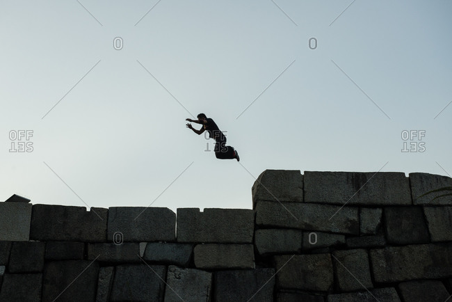 Man jumping on wall of Osaka Castle