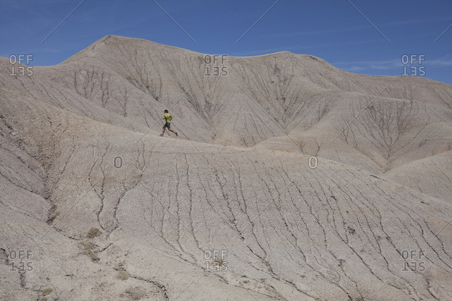 A man running in a moonscape