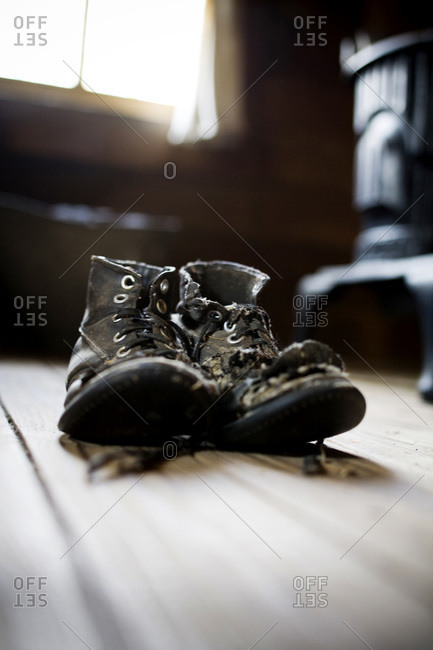 An old pair of boots in an old cabin
