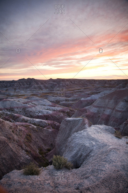 Badlands National Park, South Dakota, beneath a dramatic sky as dusk falls