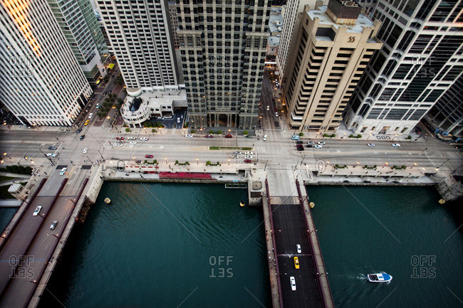 Chicago, IL, USA - July 5, 2010: An aerial view of a busy intersection in a large city with a green river running through it