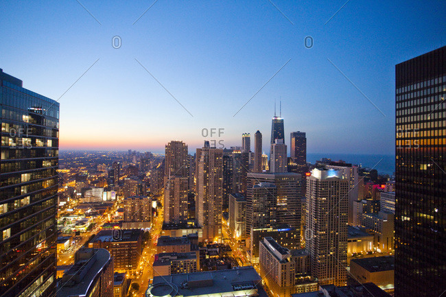 Chicago, IL, USA - July 5, 2010: City lights glow at dusk on a clear evening